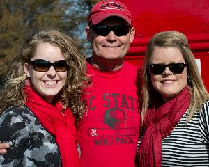 Charles with Laine and Emily tailgating at game